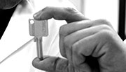 Worker´s hand holding a key
